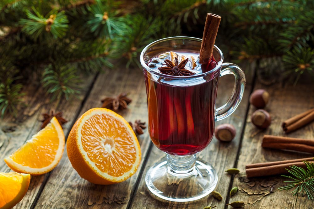 Mulled wine traditional hot spiced alcohol beverage in glass cup